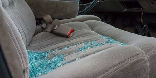 A defective seat belt and shattered lying on the seat of car in Houston.