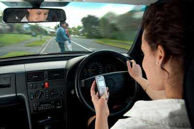 A woman texting while driving