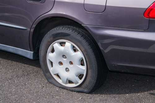 A vehicle with a flat tire.