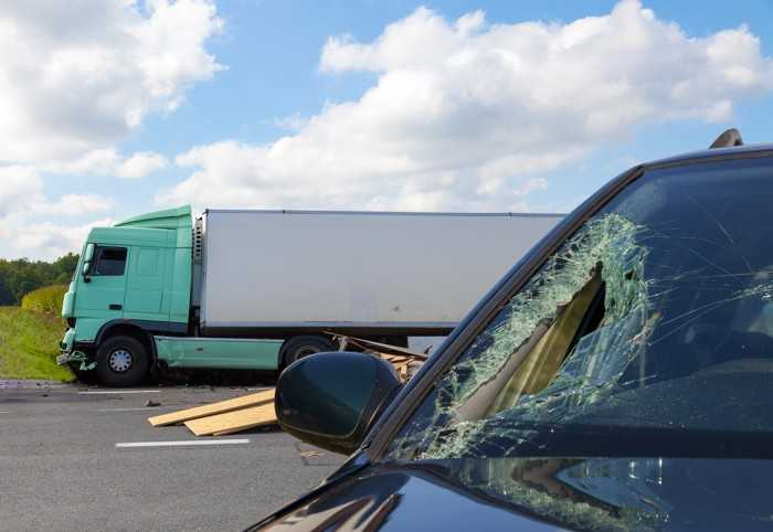 An SUV damaged in an accident with a truck in Houston.